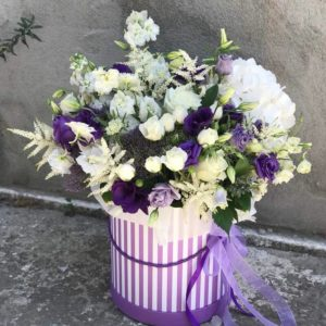 White and purple flowers in a box
