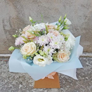 Bouquet of roses, chrysanthemums, eustomas in pastel shades