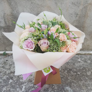 Delicate bouquet of roses and eustoma